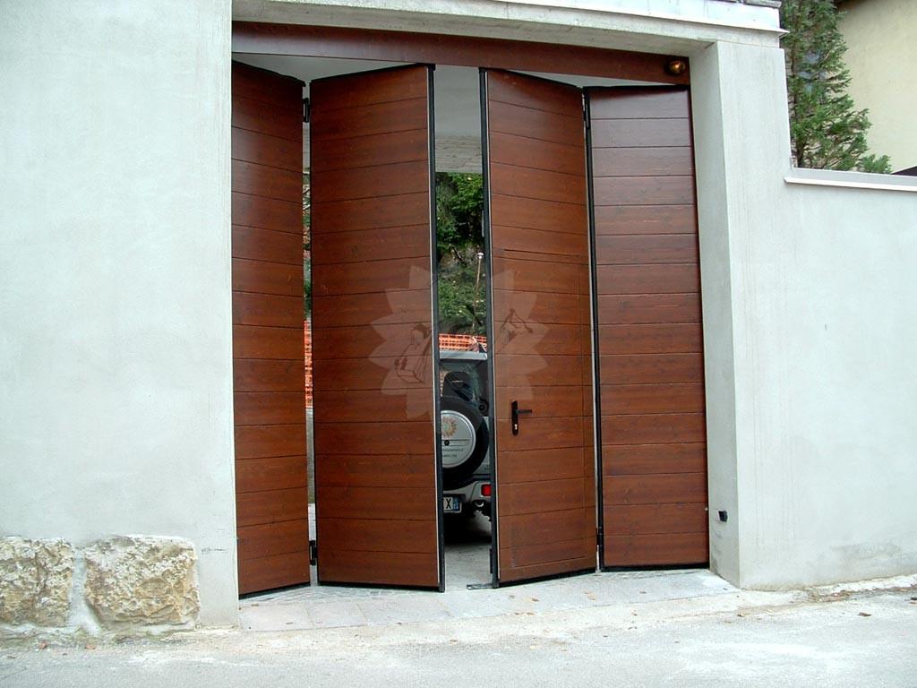 Portoni garage a libro pannelli termoisolanti - Porta garage scorrevole ...